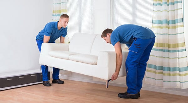 Furniture Movers Removing Couch